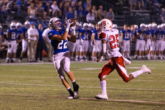 Bishop Chatard high school's wide receiver Andrew Sowinski (22) makes a catch late in the game and takes it in for a touchdown. The Bishop Chatard Trojans played host to the Southport Cardinals in a non conference varsity football game Friday, September 20, 2019.