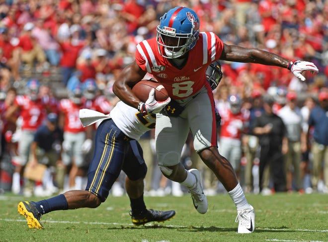 California cornerback Traveon Beck (22) tackles Mississippi wide receiver Elijah Moore (8) during the second half of an NCAA college football game in Oxford, Miss., Saturday, Sept. 21, 2019. California won 28-20. (AP Photo/Thomas Graning)