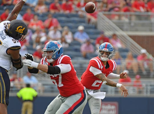 Mississippi quarterback Matt Corral (2) releases a pass during the second half of an NCAA college football game against California in Oxford, Miss., Saturday, Sept. 21, 2019. California won 28-20. (AP Photo/Thomas Graning)