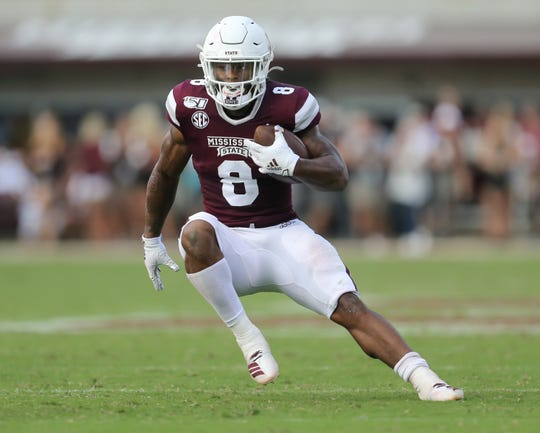 Mississippi State's Kylin Hill (8) makes a move on a defender in the second half. Mississippi State and Kentucky played in an SEC college football game on Saturday, September 21, 2019 at Davis Wade Stadium in Starkville. Photo by Keith Warren