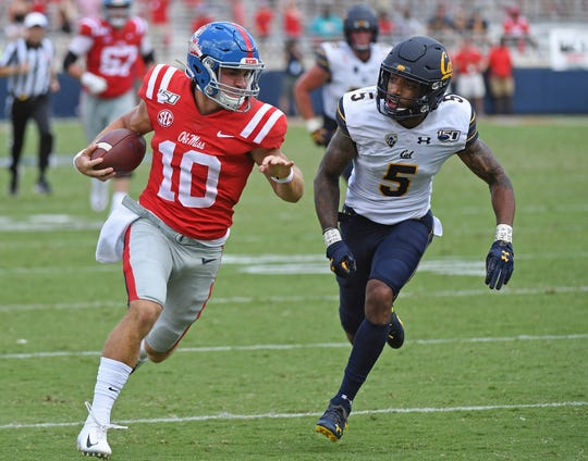 Mississippi quarterback John Rhys Plumlee (10) runs the ball as California safety Trey Turner III (5) pressures during the second half of an NCAA college football game in Oxford, Miss., Saturday, Sept. 21, 2019. California won 28-20. (AP Photo/Thomas Graning)