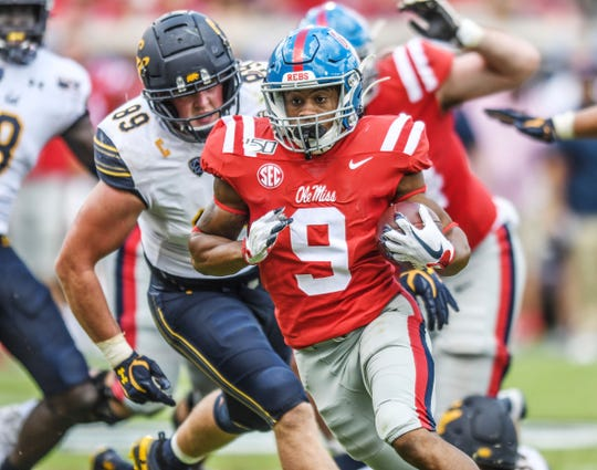 Ole Miss running back Jerrion Ealy (9) scores against California at Vaught-Hemingway Stadium in Oxford, Miss. on Saturday, September 21, 2019. California won 28-20. (Bruce Newman, Oxford Eagle via AP)