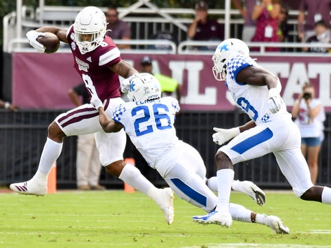 Sep 21, 2019; Starkville, MS, USA; Mississippi State Bulldogs running back Kylin Hill (8) runs the ball as he is defended by Kentucky Wildcats defensive back Brandin Echols (26) during the first quarter at Davis Wade Stadium. Mandatory Credit: Matt Bush-USA TODAY Sports