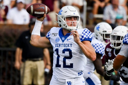 Sep 21, 2019; Starkville, MS, USA; Kentucky Wildcats quarterback Sawyer Smith (12) looks to pass against the Mississippi State Bulldogs during the first quarter at Davis Wade Stadium. Mandatory Credit: Matt Bush-USA TODAY Sports