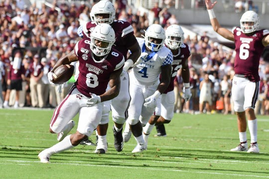 Sep 21, 2019; Starkville, MS, USA; Mississippi State Bulldogs running back Kylin Hill (8) runs the ball against the Kentucky Wildcats during the second quarter at Davis Wade Stadium. Mandatory Credit: Matt Bush-USA TODAY Sports