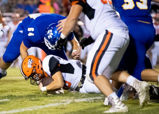 South Gibson's Nolan Stidham (10) is tackled against McNairy Central at Don Whitaker Stadium on Friday, Sept. 20, 2019.