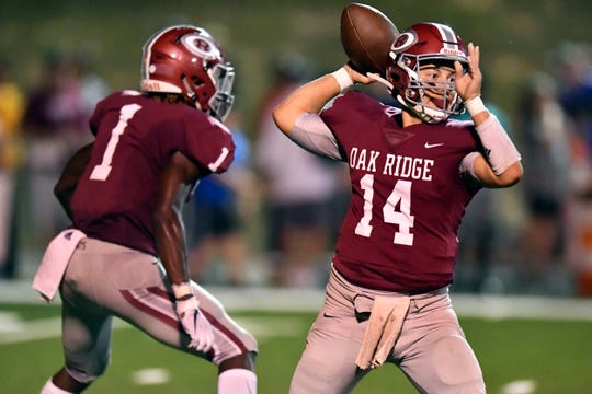 Oak Ridge's Mitchell Gibbons (14) looking for an open receiver in the game against West on Friday, September 20, 2019.