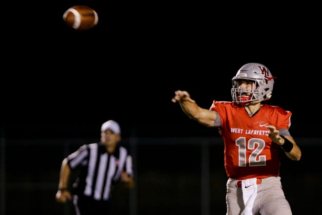 West Lafayette quarterback Kyle Adams (12) throws during the third quarter of an IHSAA football game, Friday, Sept. 20, 2019 in West Lafayette. West Lafayette won 44-6.
