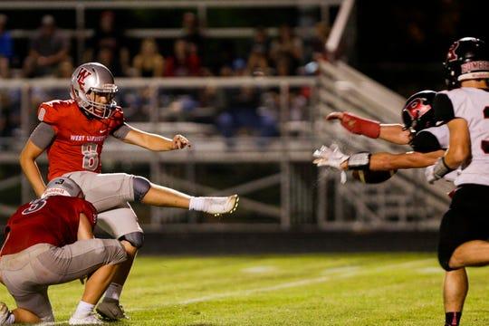 Rensselaer's Luke Standish blocks a West Lafayette kick.