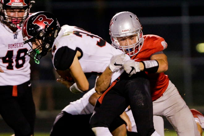 West Lafayette linebacker Jayce Flannelly (81) tackles Rensselaer's Addison Wilmington (34) during the fourth quarter of an IHSAA football game, Friday, Sept. 20, 2019 in West Lafayette. West Lafayette won 44-6.