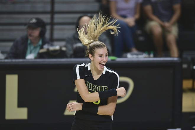 Purdue outside hitter Grace Cleveland celebrates during a career day for the sophomore Saturday against Eastern Michigan.