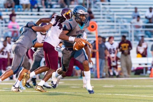 Quarterback Dillion Monette runs the ball as Southside takes on Franklin. Friday, Sept. 20, 2019.