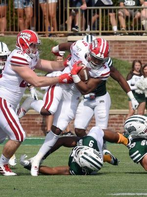 Cajuns running back Trey Ragas runs through traffic against Ohio on Saturday at Peden Stadium in Athens. Ragas ran a third-quarter touchdown.