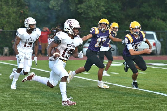Breaux Bridge's Kavon Martin (19) finds his way to the end zone against St. Martinville on Friday, September 20, 2019.