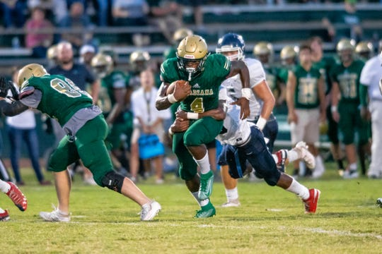 """Acadiana's Jeremiah """"Lucky"""" Brooks runs the ball with a defender on his back as the Acadiana high school Wreckin' Rams take on the Lafayette Christian Academy Knights on Friday, Sept. 20, 2019."""