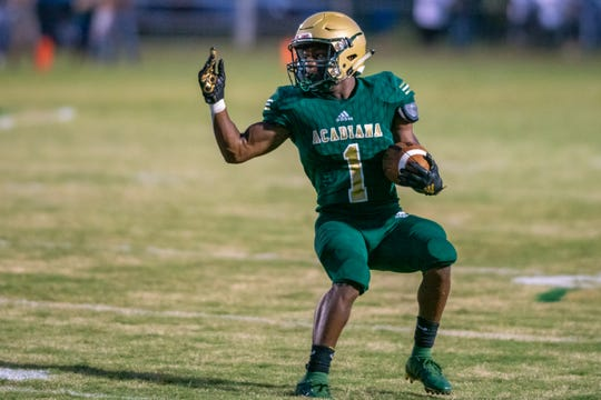 Acadiana's Dillon Monette fakes out the defense during his run as the Acadiana high school Wreckin' Rams take on the Lafayette Christian Academy Knights on Friday, Sept. 20, 2019.
