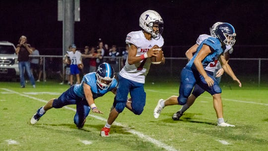North Vermilion's Darius Giliam runs in the winning touchdown as the North Vermilion Patriots face off against Ascension Episcopal Blue Gators Friday, Sept. 20, 2019.
