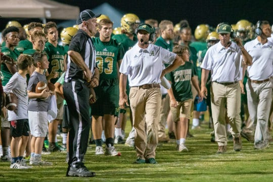 Acadiana's head coach Matt McCullough disputes a call with an official as the Acadiana high school Wreckin' Rams take on the Lafayette Christian Academy Knights on Friday, Sept. 20, 2019.