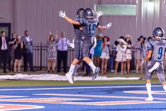 Rhett Pelloquin scores a touchdown and celebrates with Jack Pruitt as Southside takes on Franklin. Friday, Sept. 20, 2019.
