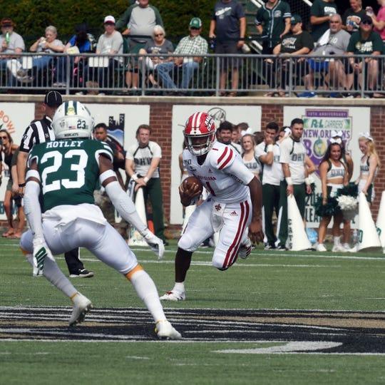 Ragin' Cajuns quarterback Levi Lewis runs with the ball during Saturday's win at Ohio.