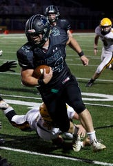 Fisher Catholic senior running back Trey Fabrocini was named as the Division VII Central District Offensive Player of the Year.