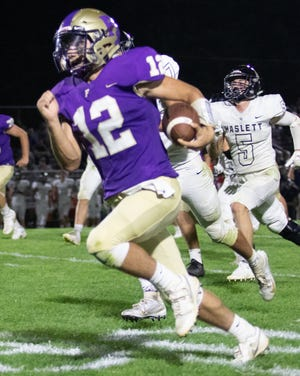 Fowlerville's Kyle Lutz takes off for a 50-yard touchdown run in a 34-21 victory over Haslett on Friday, Sept. 20, 2019.