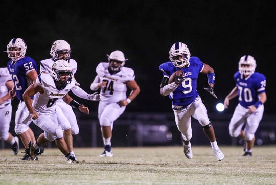 Charlestown's Marion Lukes runs down the field for his second touchdown against visiting Providence as the Pirates defeated the Pioneers 13-7 Friday night.