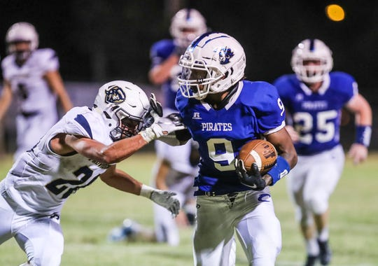 Charlestown's Marion Lukes pushes back Providence's Colin Flake during the game at Charlestown High School.