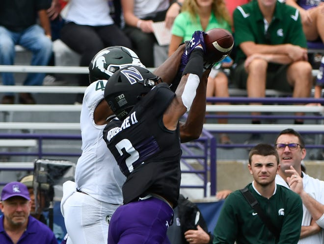 Sep 21, 2019; Evanston, IL, USA; Northwestern Wildcats defensive back Greg Newsome II (2) breaks up a pass meant for Michigan State Spartans wide receiver C.J. Hayes (4) during the first half at Ryan Field. Mandatory Credit: Matt Marton-USA TODAY Sports