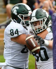 Sep 21, 2019; Evanston, IL, USA; Michigan State Spartans tight end Noah Davis (84) celebrates with Michigan State Spartans tight end Matt Seybert (80) after he scored a touchdown against the Northwestern Wildcats during the second half at Ryan Field. Mandatory Credit: Matt Marton-USA TODAY Sports
