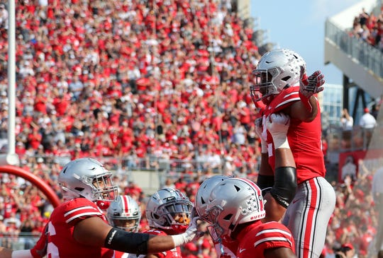 Ohio State tailback J.K. Dobbins celebrates his 26-yard touchdown run with teammates in the 76-5 romp past Miami of Ohio.