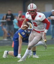 Shelby's McGwire Albert completed 14-of-23 passes for 245 yards and four touchdowns to three different receivers in a 42-7 win over Ontario Friday night.