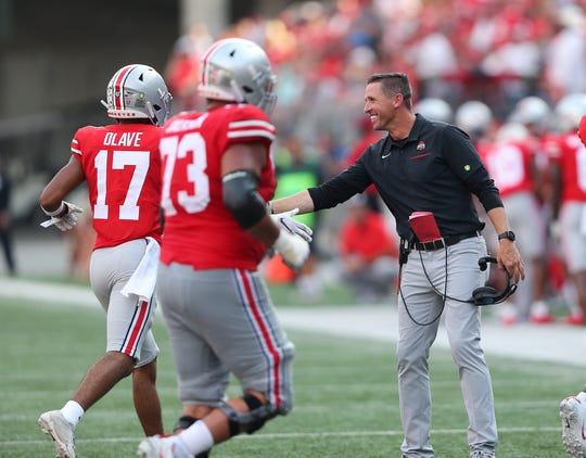 Ohio State assistant coach Brian Hartline had reason to smile Saturday as his receivers caught six touchdown passes in the 76-5 victory over Miami.