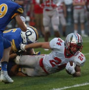 Shelby's Owen Fisher ran for 222 yards on 24 carries with touchdown runs of 60, 32 and 10 yards while also adding a 78-yard touchdown catch in Shelby's 54-33 win over Pleasant.