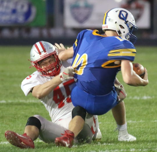 Shelby's Carson Ingram makes a tackle against Ontario in Week 4 as the Whippets made a defensive statement with nine sacks as a team.