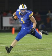 Ontario's Cody Mies runs the ball for the Warriors during a tough 42-7 loss to Shelby Friday night.