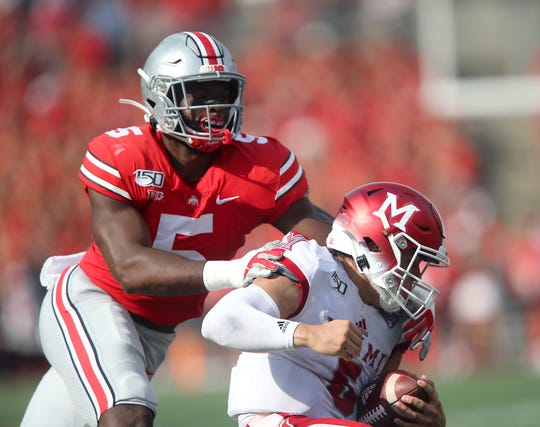 Ohio State linebacker Baron Browning tackles Miami quarterback Brett Gabbert in the first half of Saturday's 76-5 rout.