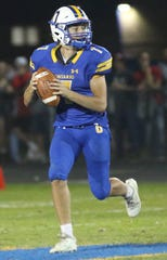Ontario's Ethan Snyder looks for an open receiver on Friday night in a loss to Shelby.