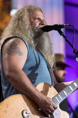 Country singer Jamey Johnson (with Randy Houser in the background) performs at Farm Aid Saturday, Sept. 21, 2019, at Alpine Valley Music Theatre in East Troy, Wis.