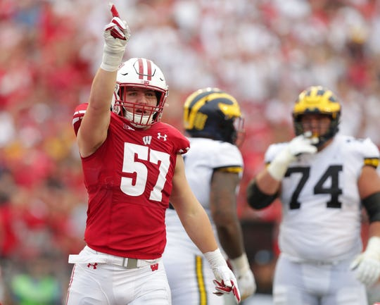 Badgers inside linebacker Jack Sanborn celebrates a tackle during the first half against Michigan.