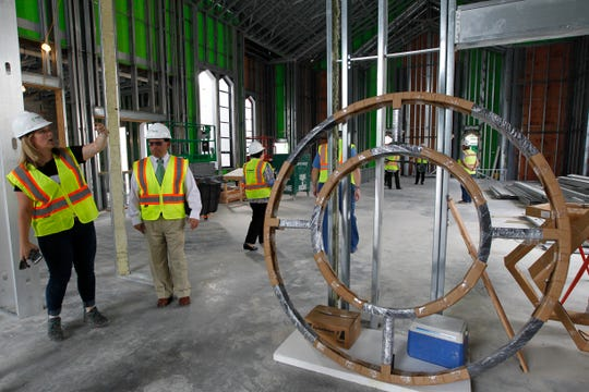 This rose window, six feet in diameter, is the only new piece of stained glass that crews will put in St. Rita Catholic Church. It will depict the Three Holy Women Parish logo, of which St. Rita is a part.
