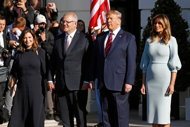 President Donald Trump and first lady Melania Trump welcome Australian Prime Minister Scott Morrison and his wife, Jenny Morrison,  during on the South Lawn of the White House on Friday.