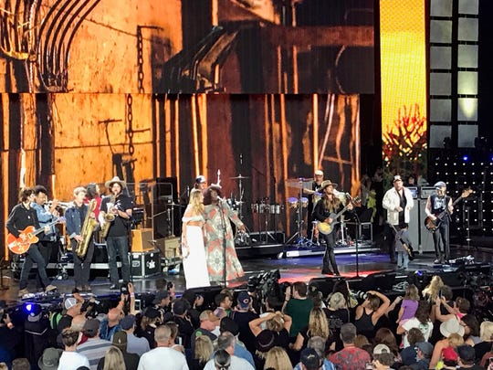Lukas Nelson, and his band Promise of the Real are joined onstage by the Night Sweats, far left, Margo Price and Yola, and Nathaniel Rateliff, far right (in white overshirt) at Farm Aid 2019 on Saturday, Sept. 21, 2019, at Alpine Valley Music Theatre in East Troy, Wis.