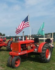 Joel Greeno, a farmer from Kendall, drove this 1935 Allis Chalmers tractor part of the way to Farm Aid 2019.