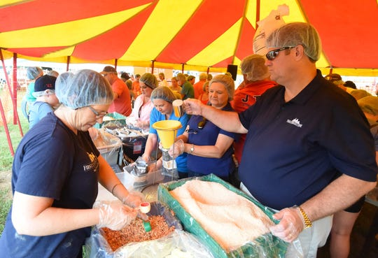 Volunteers assemble one of the 100,116 meals packaged for those in need at Saturday's Bridge Bash event on the campus of Arkansas State University-Mountain Home.