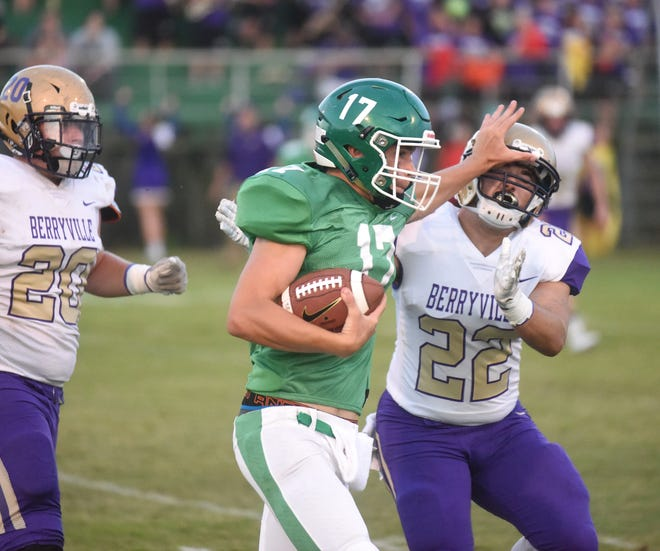 Yellville-Summit's Eli Cagle stiff arms Berryville's Tyler Payne during the Panthers' loss to the Bobcats on Friday.