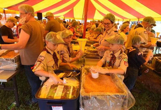 Volunteers prepared and packed more than 100,000 meals Saturday at the Food Bank of North Central Arkansas' Bridge Bash community event.