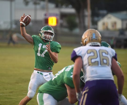 Yellville-Summit quarterback Eli Cagle takes a high snap during a game earlier this season.