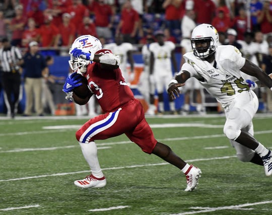 Louisiana Tech redshirt junior Justin Henderson (33) breaks a run against FIU during Conference USA action Friday, Sept. 20, 2019 at Joe Aillet Stadium.