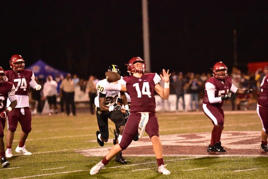 Ouachita quarterback Zach Shaw (14) drops back to pass in last Friday's 38-35 loss to Neville. Shaw's touchdown throw to D.J. Jacobs gave the Lions the lead with 2:13 remaining.